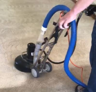 Image of carpet cleaning machine transforming dirty carpet to clean.